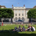 people relaxing in the public Palace Garden behind Noordeinde Palace; The Hague, Netherlands